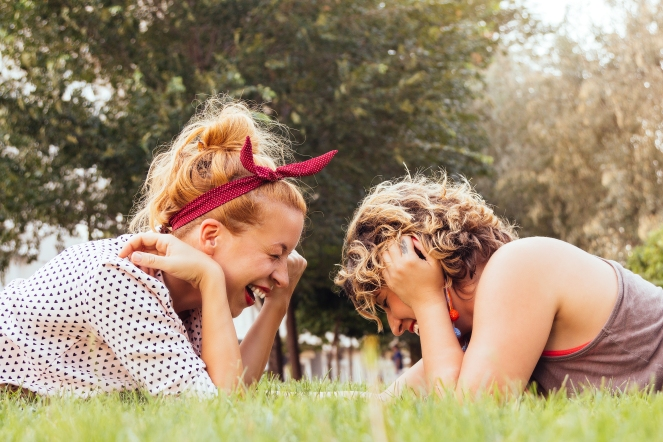 Girlfriends laughing in the park